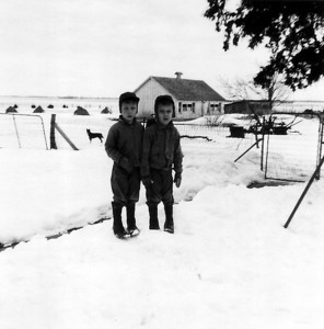 Larry and Paul Hornbaker in snow with Blackie the dog, circa 1960