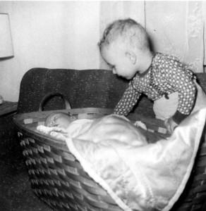 Larry Hornbaker with Paul Hornbaker in basket, 1956