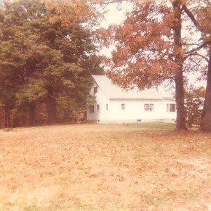 Probably the fall of 1980 or 1981. The house was originally blue (you can see the blue peak where we couldn't reach with our ladder). There's an entry door next to the bay window on the right. There's no dormer. The corner of the house that later became the front porch was my bedroom at the time.