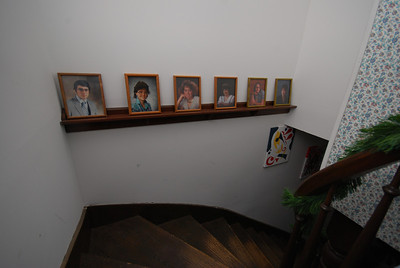 This staircase was salvaged from another house in Cloverdale; it was the only thing still standing. I always liked this very simple shelf with each kid's senior photo.
