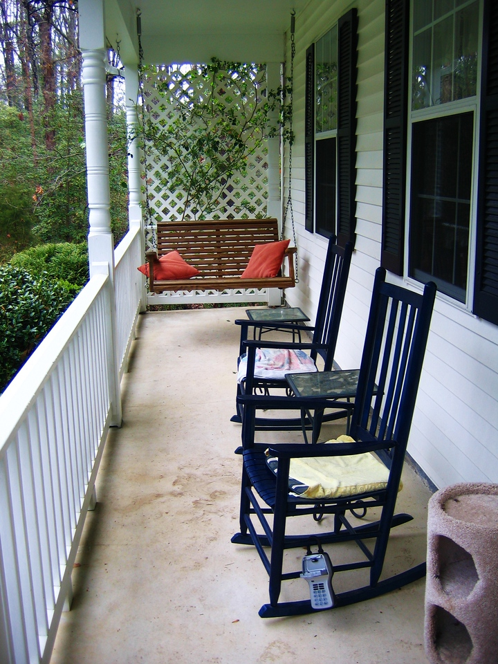 The front porch comes with a swing and rockers.