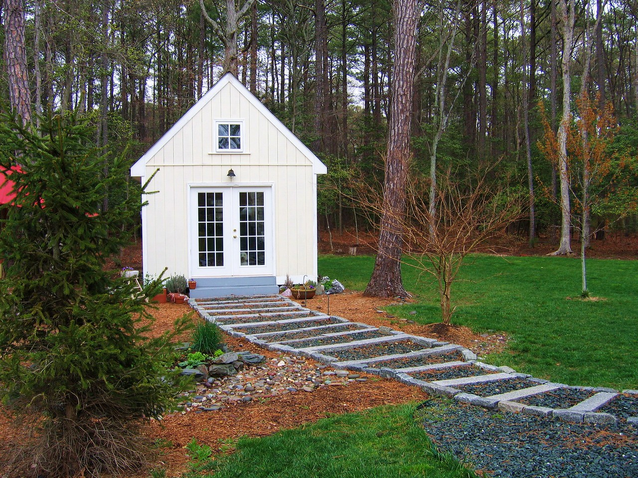 The steps that lead to the shed or utility room are well designed and complements the house.