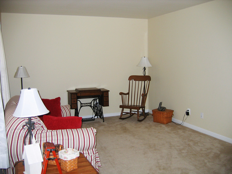 As you walk in to the left is the formal living room.  The walls are neutral color, flat wall paint.