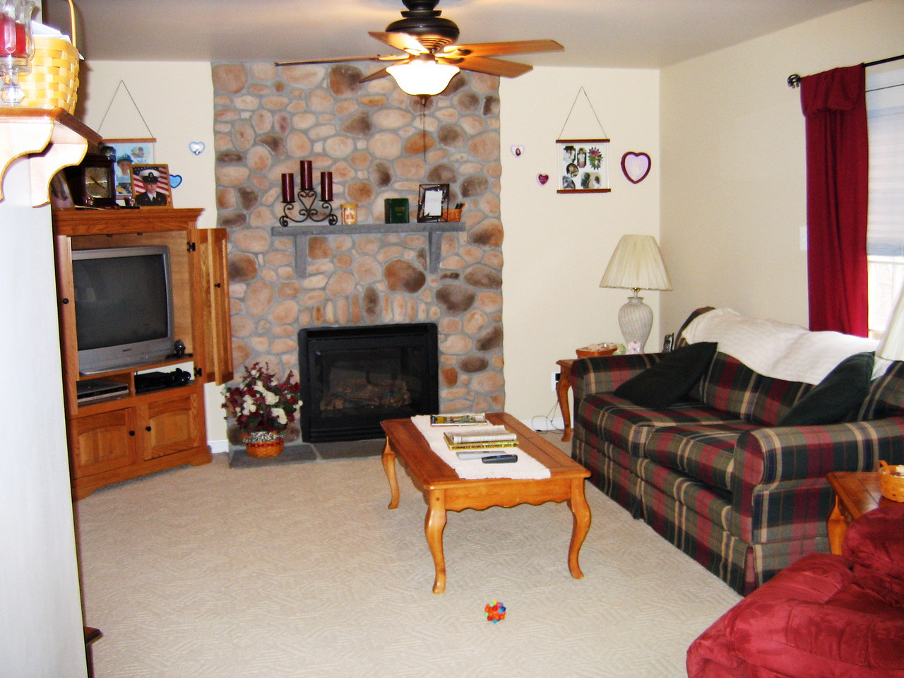 Past the entryway to the left is the living room with gas fireplace.