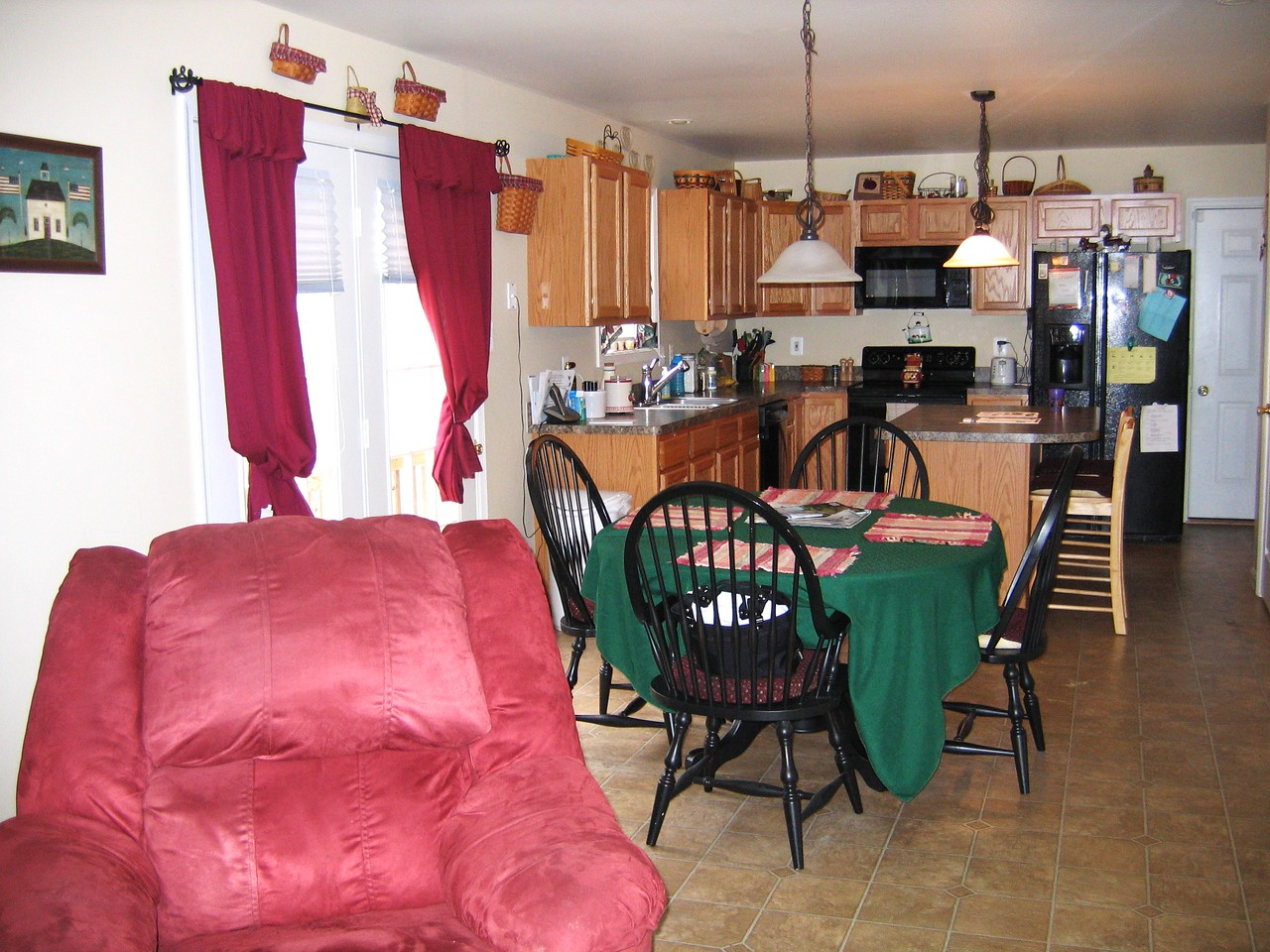 This picture is taken from the middle of the family room towards the kitchen.