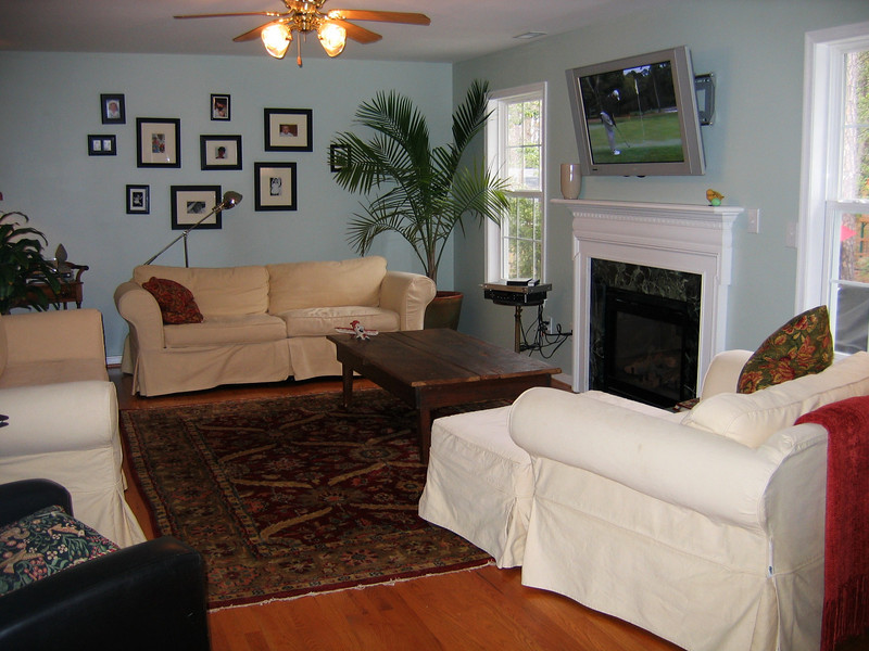 Past the dining room is a very large family room with oak floors and the 42 inch plasma television is included with the house.  The entire living room is wired for surround sound.  The fireplace is gas.