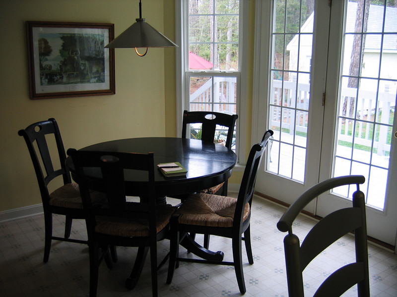 The dining area leads to a very large bay window and French doors to the back deck.