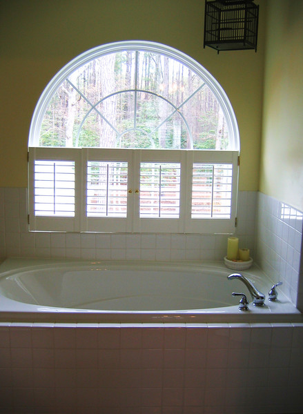 The master bath has a jacuzzi tub and separate shower.  It is larger than the other bathrooms I've seen.