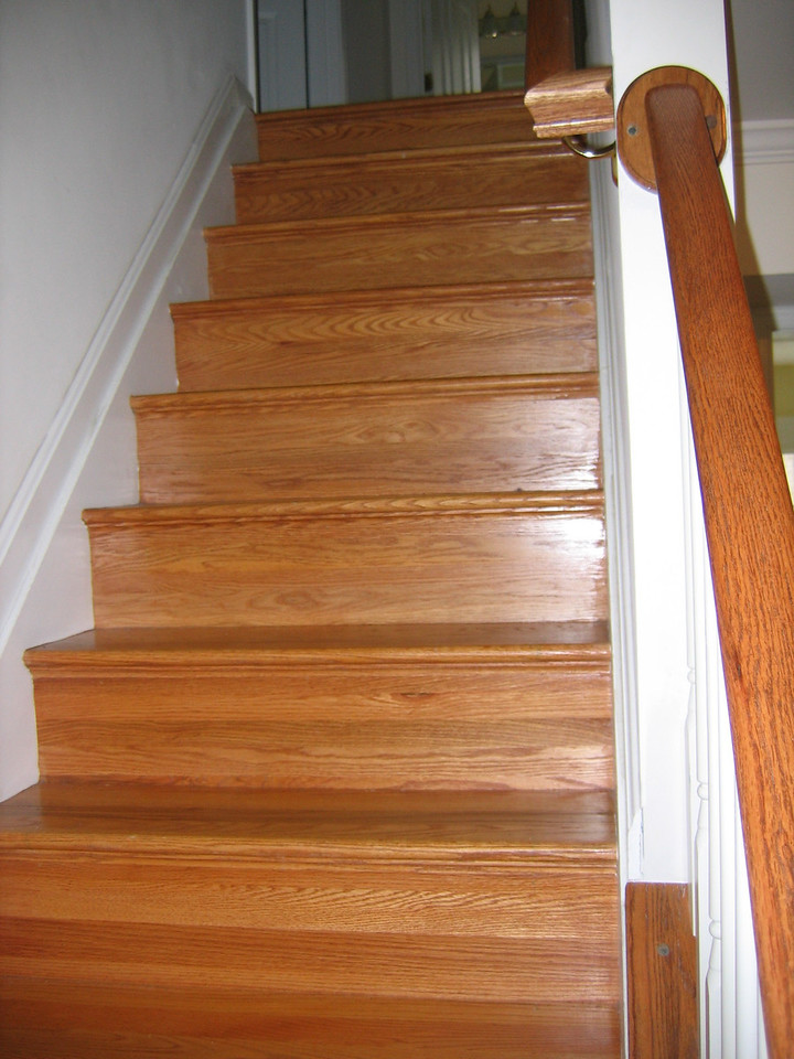 As you turn left from the entryway are the oak stairs that lead to the upper level.