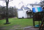 Back yard video view facing the house with the barely visible neighbors in the background.