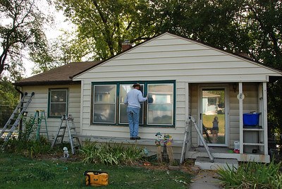Before: Gutters/soffits were dark brown. Window trim was brown or teal or a combination, depending on the window!