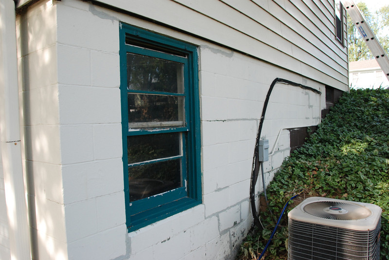 North side of house, before.