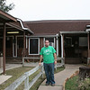 Me in front of a bbq place named Brother-In-Laws BBQ.