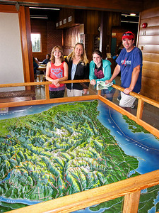 Natalie, Paris, Tawnee adn Bob check out the relief map at the visitor center.
