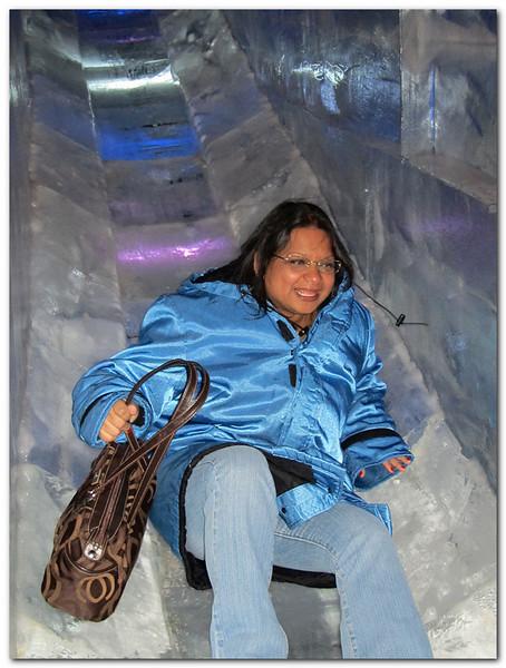 Sherrill follows Peyton goes down the ice slide