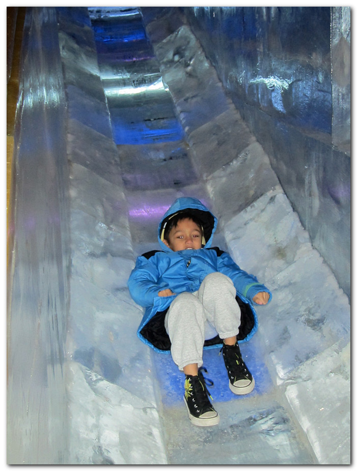 Peyton goes down the ice slide