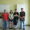 Ian, Emily, Alex, Dave - posed at Divine Designs showroom on Bayfield St