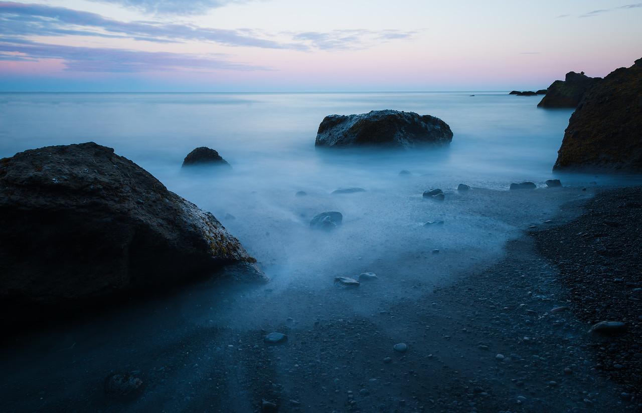 Long Exposure shot at sunset on black sand beach at Vik
