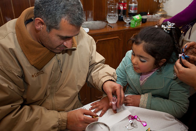 Zainab was gong to a party with her Mom and Dad and gets prepared by Adil who is painting her fingernails!