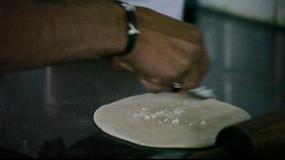 Yasir shows the proper technique to make Parathas.  I could not understand why he had to put so much ghee in there....but there it is.