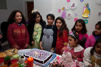 Zeenat ready to blow out the candles.