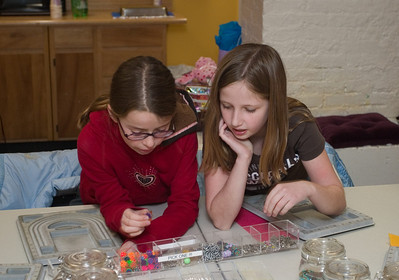 Nina and Cami picking out out beads and planning a necklace.  They decided to make matching ones.