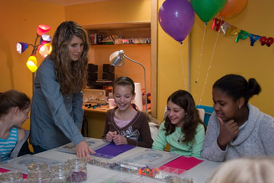 """The birthday girl with her frients at """"U Bead"""".  You can make your own necklace there.  The girl on the left helps them out.  She was very good with the kids."""
