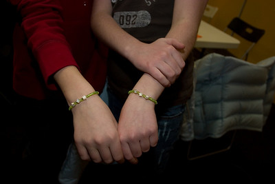 The firls showing their bracelets.