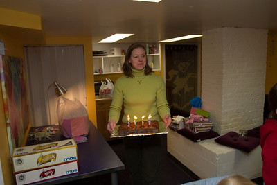 Linda out with the cake.  THe party was in the basement of the store...which is in Wayne.