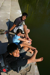 The kids wanted to dip their feet into the lake.  They  walked barefoot all over.