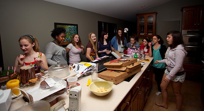 The girls in the kitchen waiting for the cake to be ready.
