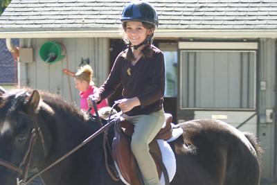 Anisa mounted on Bridget.