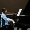 Anisa warming up on the Piano in Rielly Theater, which is why she still has her fleece on.