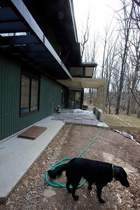 The patio being built.  This is the stage where the slate has been cut and is being placed to make sure it fits. Zaby really liked the readio station the builders listened to outside his window!