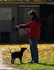 Out at the Riding Stables.  Jeff playing with Shadow.