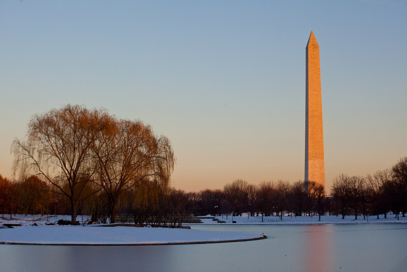 A frozen lake in front of the Washington Monument.