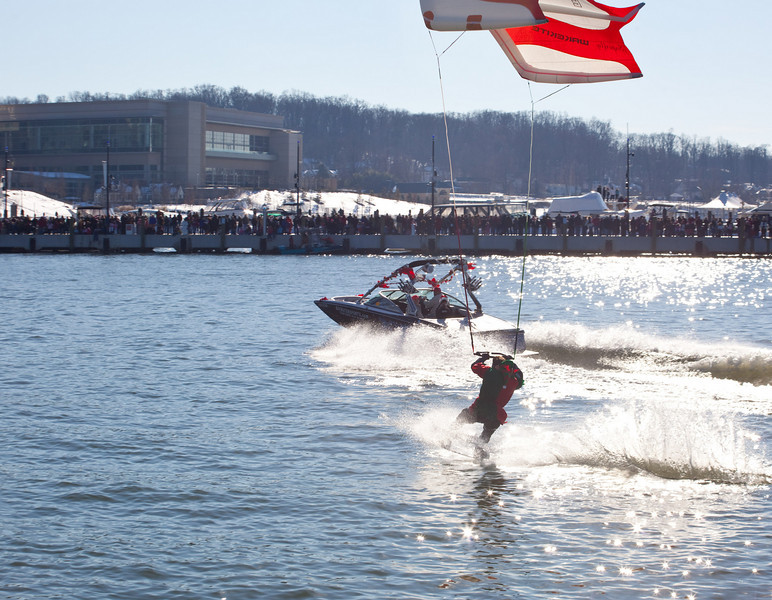 There was a huge crowd lining the pier.  I never knew the waterskiing Santa was such a big hit.  Apparently he has been doing this for 18 years.