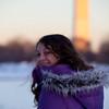 Anisa throwing snowballs onto the frozen lake.
