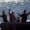 Santa and Mrs Claus wave.