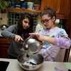 The cousins making cookies.