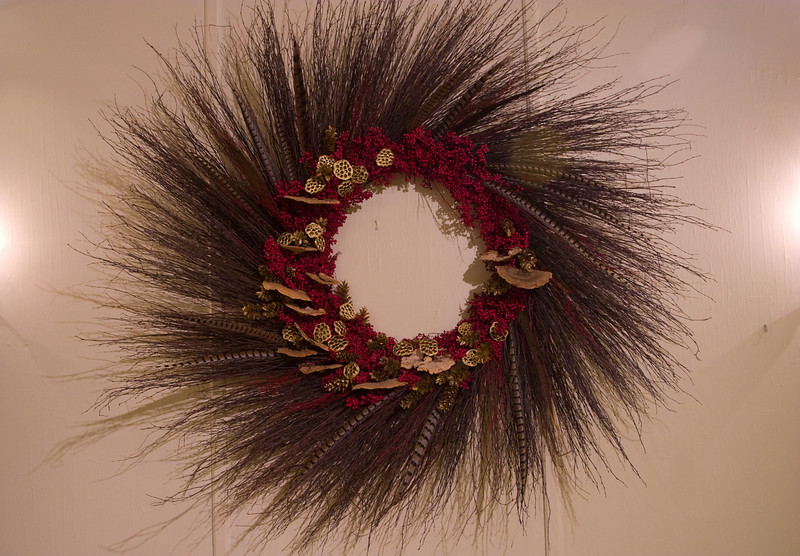 One of the wreaths with feathers imbedded in it.
