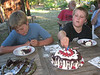 Birthday child with cake and brother