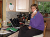 "Frannie at computer and phone, kitchen ""office"""
