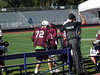 Lacrosse game sidelines action