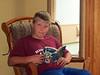 Birthday boy reading