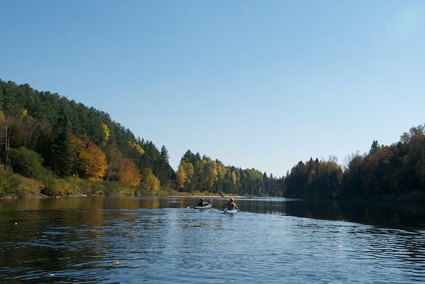 Karen and Pierre glide ahead in their speedy kayaks