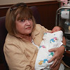 Grandmommie Janet holding Ana for the first time.