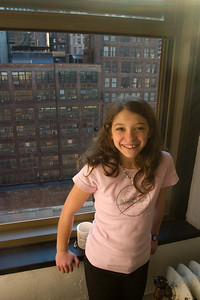 Anisa was taken in by the view.  Her mom on the other hand cowered away from the window since she is scared of heights.