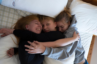 After being separated for months, Molly greets her sisters  Kate and Maggie had been napping after the long flight.