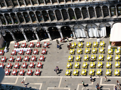 View from the tower in Piazza San Marco, Venice, of Cafe Quadri (Red chairs, established 1775) and Cafe Lavena (Yellow chairs, established 1750).
